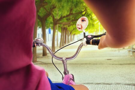 pink bike: Cute little girl cycling on pink bike in the park Stock Photo