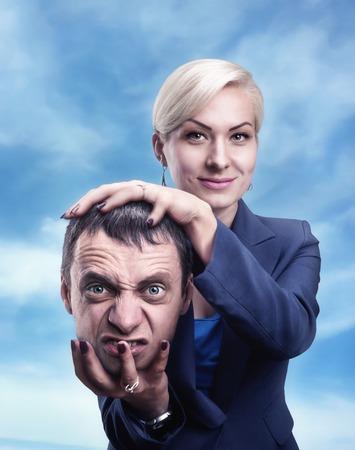 psiquico: Un ps�quico con la cabeza del hombre en su mano Foto de archivo