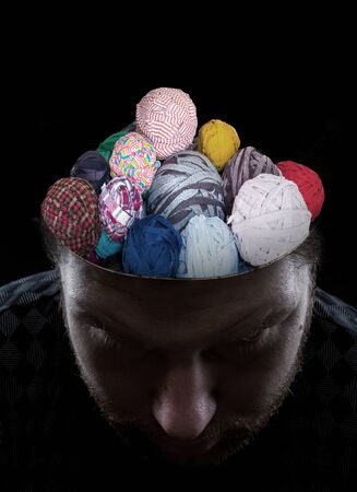 odd jobs: Young man with balls of threads instead of his brain