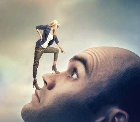 psych: Young confident personal coach is standing on the mans face