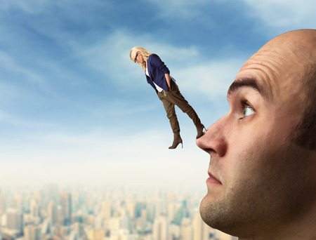 Confident analyst is walking on the mans face Stock Photo