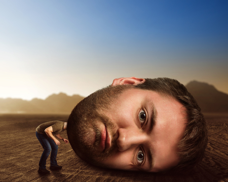 weather: Man with enormous head in the desert