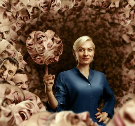 extrasensory: Businesswoman holding mens faces on the finger against mens heads