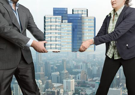 contend: Businesspeople fighting holding in their hands big office buildings
