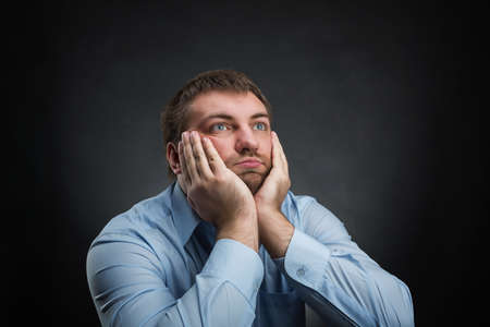 odd jobs: Thoughtful businessman is dreaming about something