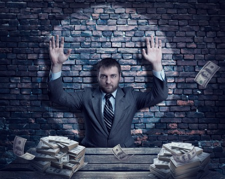 heaps: Businessman with heaps money over brick wall