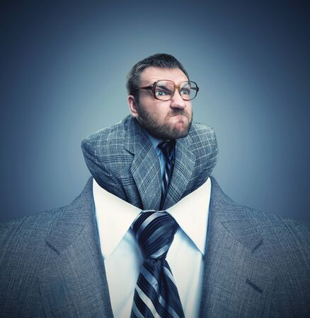 shirt: Businessman headshot with little angry businessman instead of head Stock Photo