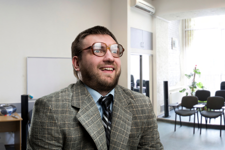 professor: Surprised nerd businessman in glasses at office