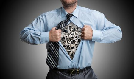 mechanism: Businessman with gears inside his shirt Stock Photo