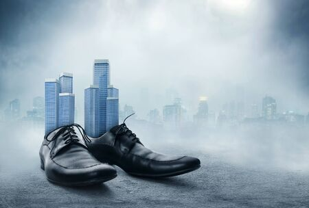 office shoes: Office buildings in the male classic shoes against the city