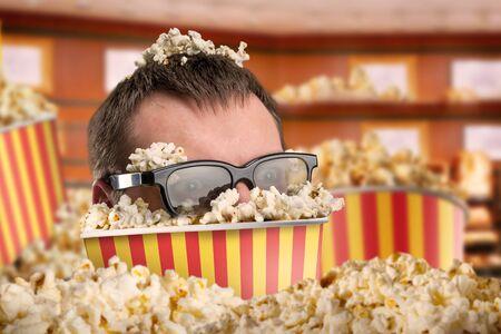 3d weird: Man in glasses in a bucket of popcorn