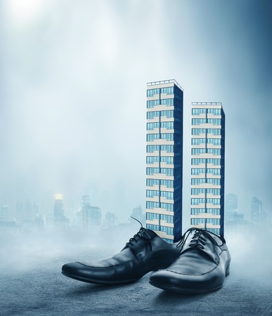 office shoes: Office buildings in the male classic shoes against the cityscape