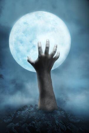 creepy hand: Creepy hand rising from the hole to the moon at night
