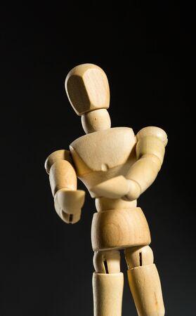 artists dummy: Human wood manikin showing something closeup Stock Photo