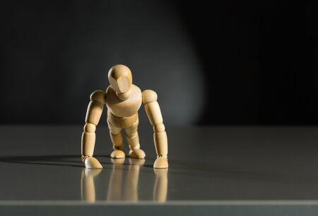 artists mannequin: Human wood manikin do push-ups against dark background
