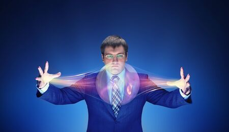 supernatural power: Businessman holding a big energy bubble with magic Stock Photo