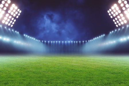 View of emty illuminated football ground at night