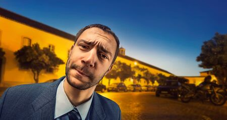 suspicious: Closeup of suspicious businessman on the street in the night Stock Photo