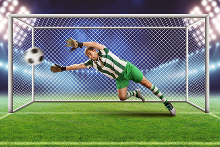 Goalkeeper catching the ball on the football field