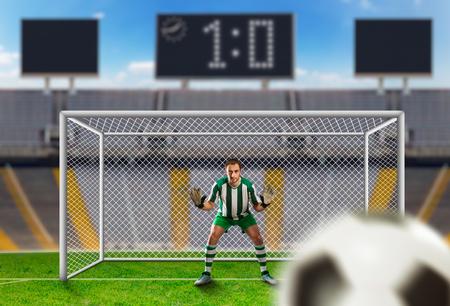arquero de futbol: Portero agarrar la pelota en el campo de fútbol