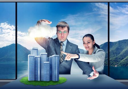 controling: Businessman shows his magic to businesswoman controling the weather