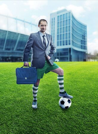 sportwear: Businessman with suitcase in sportwear against office building Stock Photo