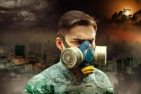 gasmask: Young man in gas-mask in night town with atmospheric pollution