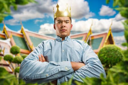 formidable: Powerful man wearing crown on the head with crossed hands as a king