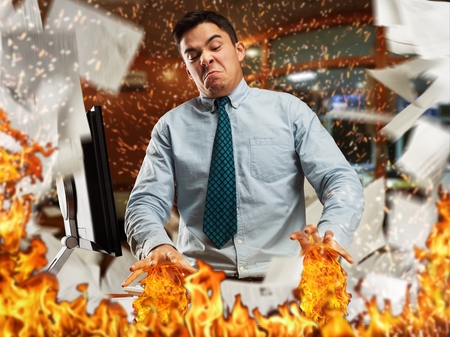 burning man: Angry businessman is burning papers in th office Stock Photo