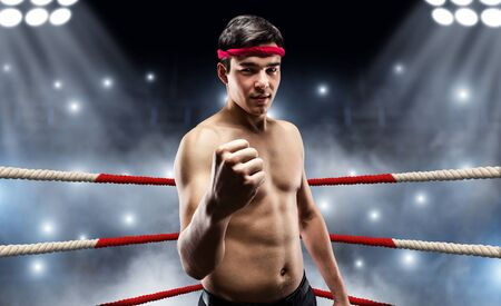 stance: Young wrestler standing on the ring