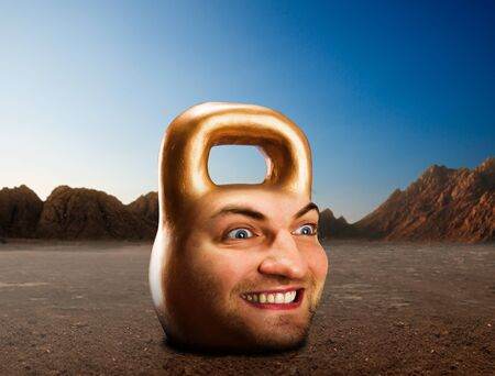 steel head: Kettlebell with male face in mountains Stock Photo