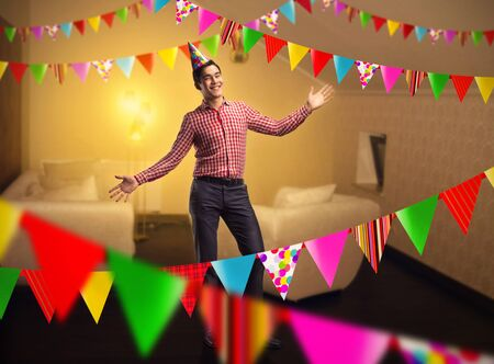 room decoration: Happy birthday boy standing in decorated room Stock Photo