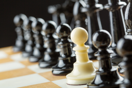 White pawn in the black chess team