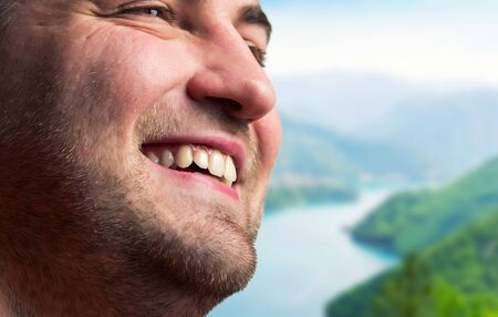 Close up of smiling man in mountains Stock Photo