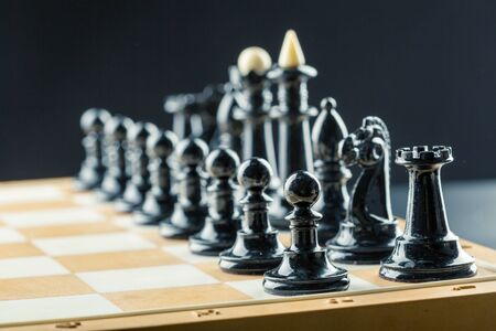 Black chess figures on the board ready to fight Stock Photo
