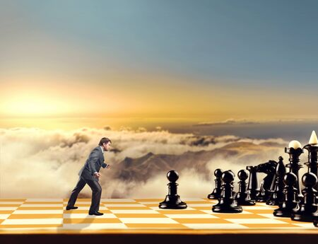 pawn adult: Businessman on the chess board fighting with black chess team in the sky