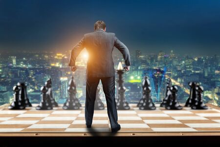 pawn adult: Businessman on the chess board ready to fight with black chess team