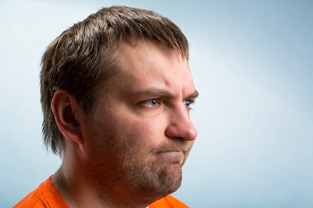 profile face: Profile of a gloomy mans face