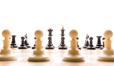 chessmen: Chess figures on the board ready for the game Stock Photo