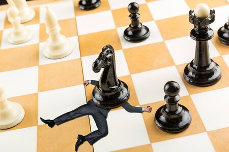 defeated: Businessman defeated on the chess board