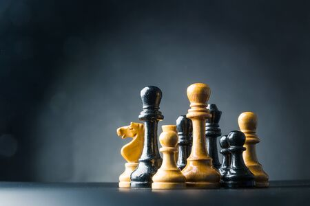 Chess figures on the table over black Stock Photo