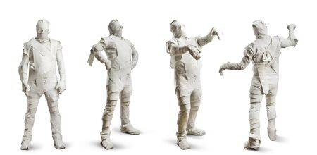 mummy: Four men in toilet paper isolated on white