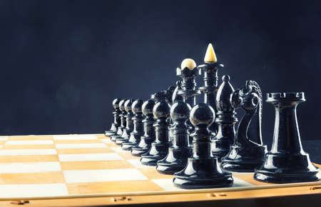 chess rook: Black chess figures on the board ready to fight Stock Photo