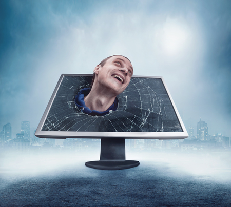 odd: Odd man looking from cracked computer display
