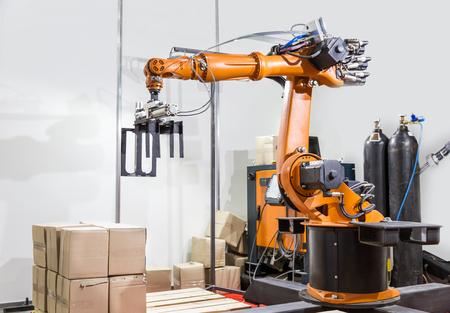 Modern arm manipulator on the factory