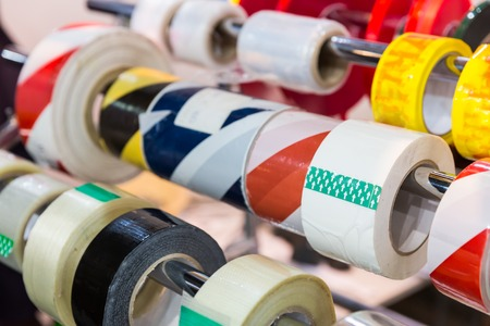 Rolls of different packing tapes in the shop close up