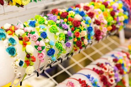 Beautiful bright chaplets with flowers in the shop Stock Photo