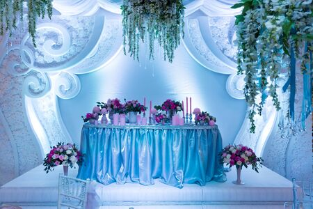 brigh: Many bouquets on the table in wedding room Stock Photo
