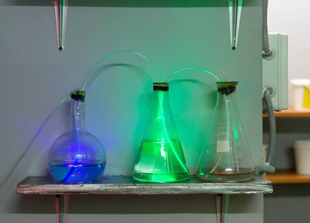 reagents: Three flasks with chemical reagents Stock Photo