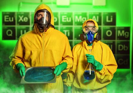 meth: Man and woman in protective suits cooking methamphetamine in the lab